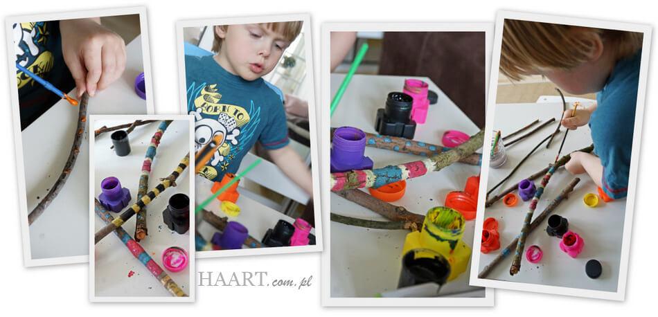 zabawa sensoryczna diy, ozdabianie patyków malowidłami przez dziecko